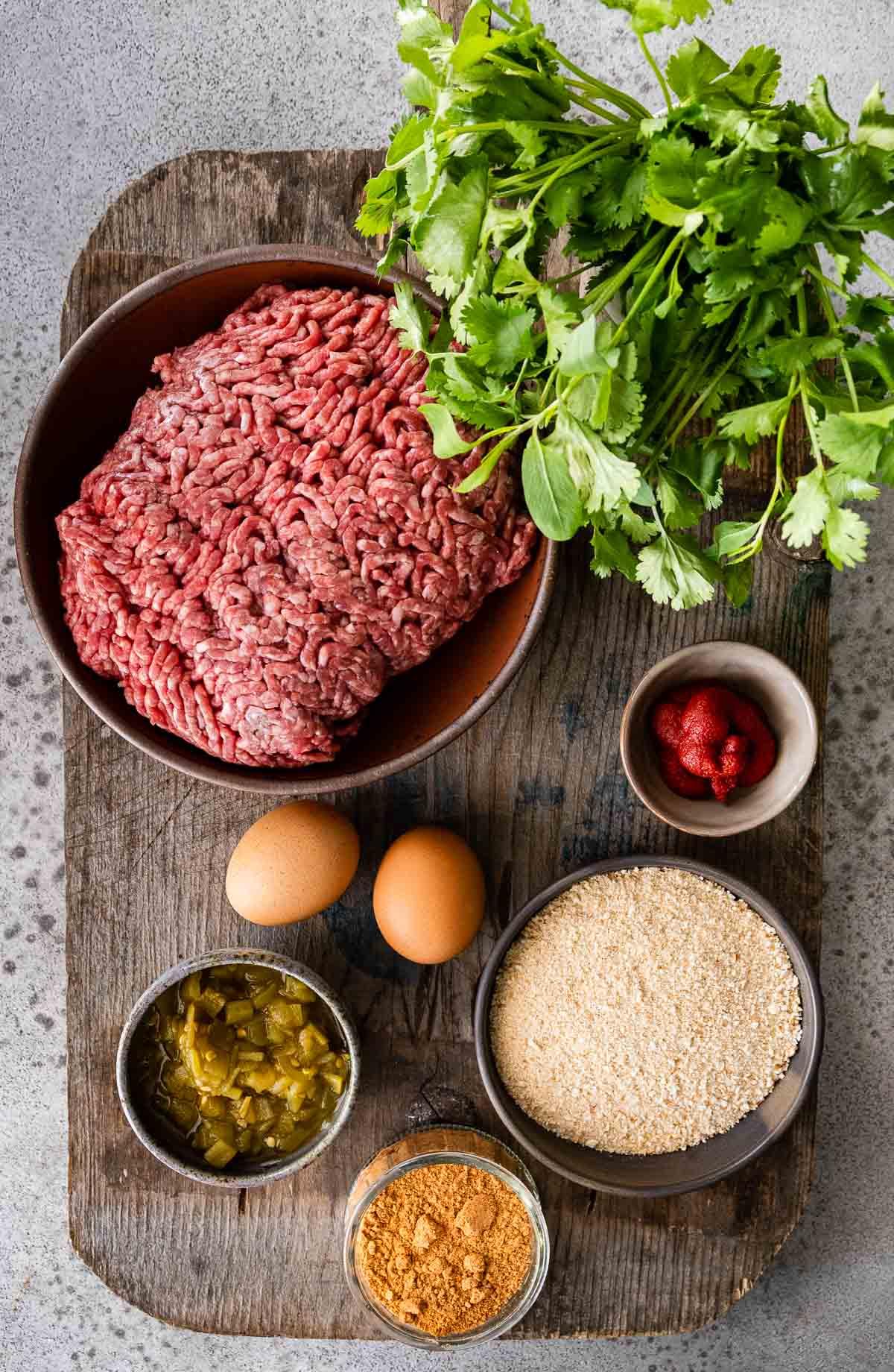 Taco Meatballs ingredients in prep bowls