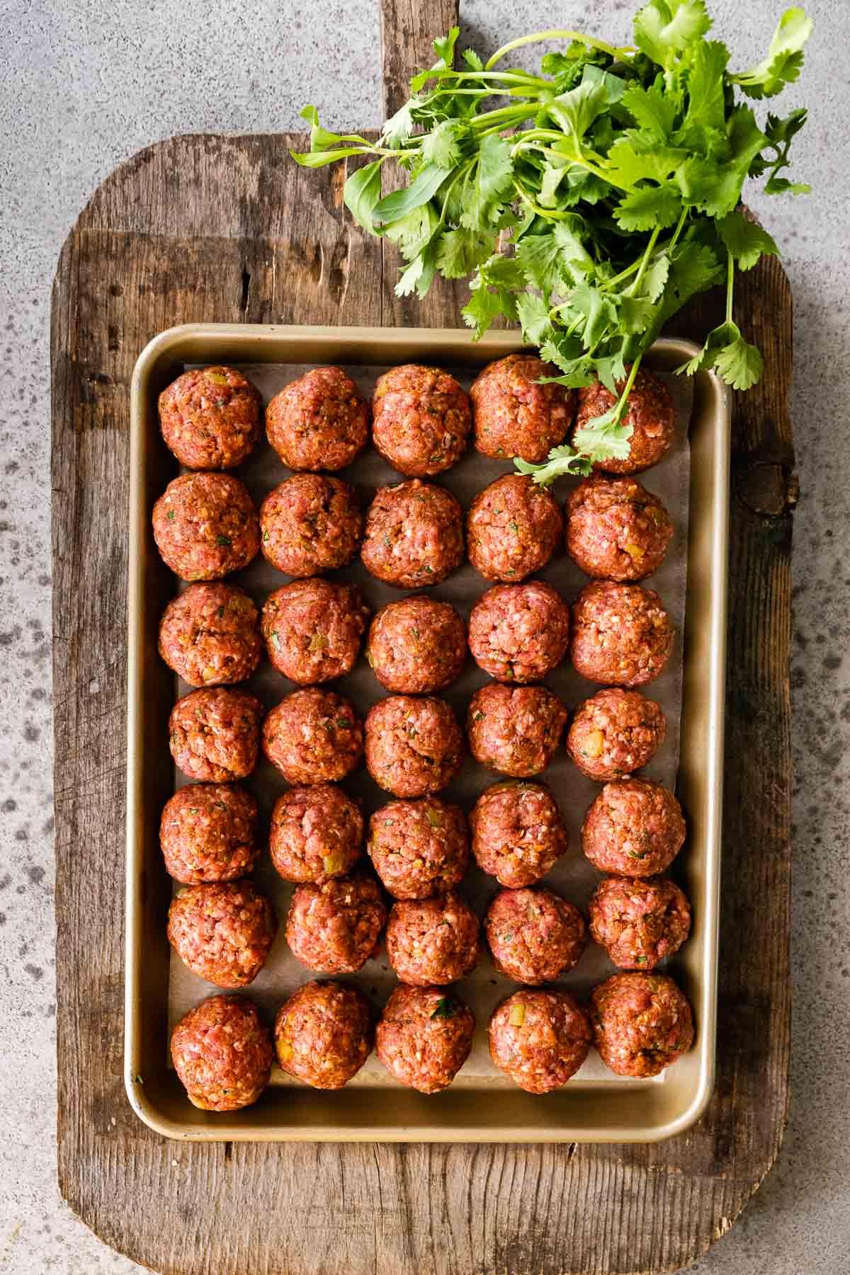 Taco Meatballs prepared on baking dish before baking