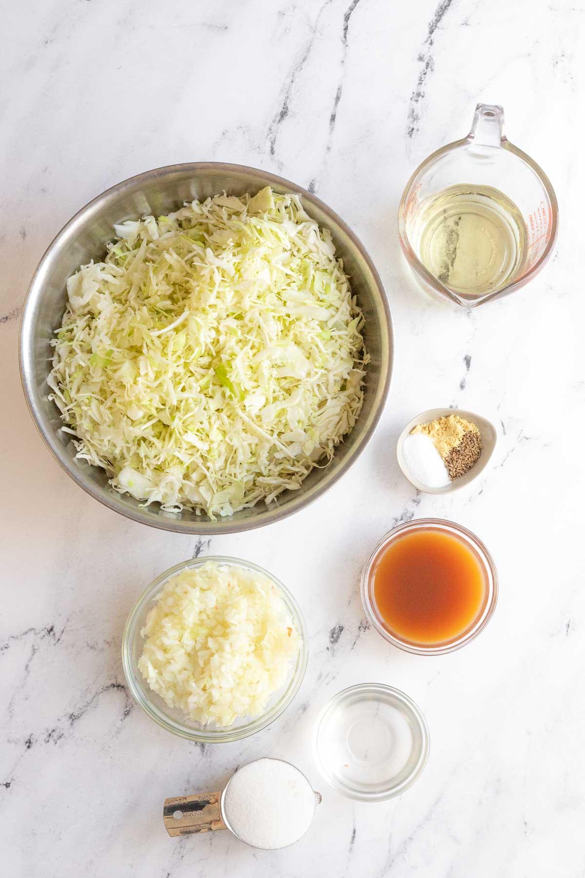 Ingredients for Amish Vinegar Slaw in prep bowls