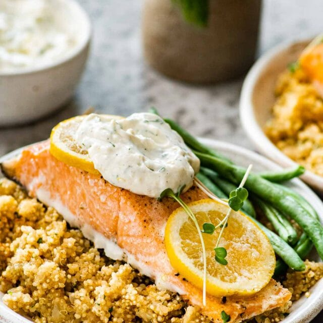 Baked Salmon with Dill Sauce served with quinoa and green beans