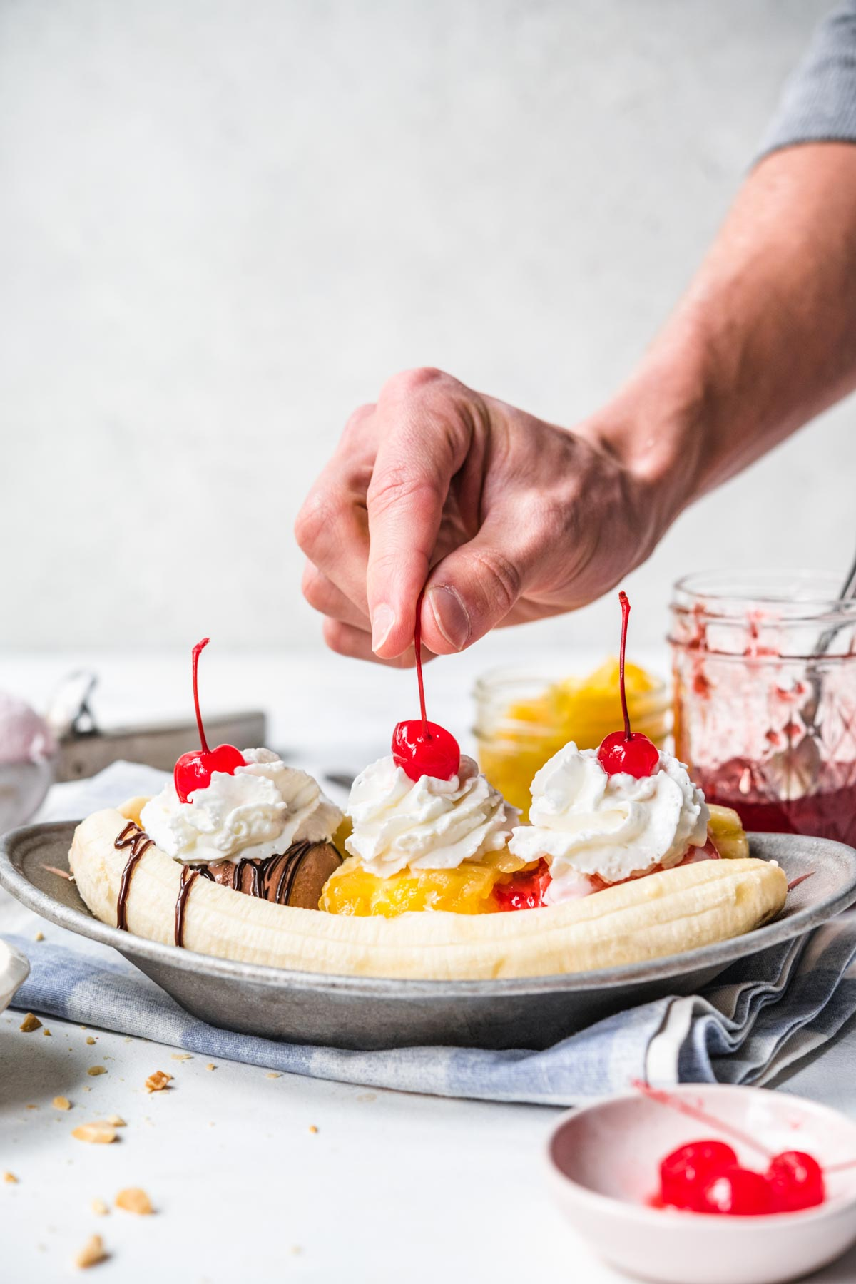 Banana Split on plate with chocolate, pineapple, and strawberry topping