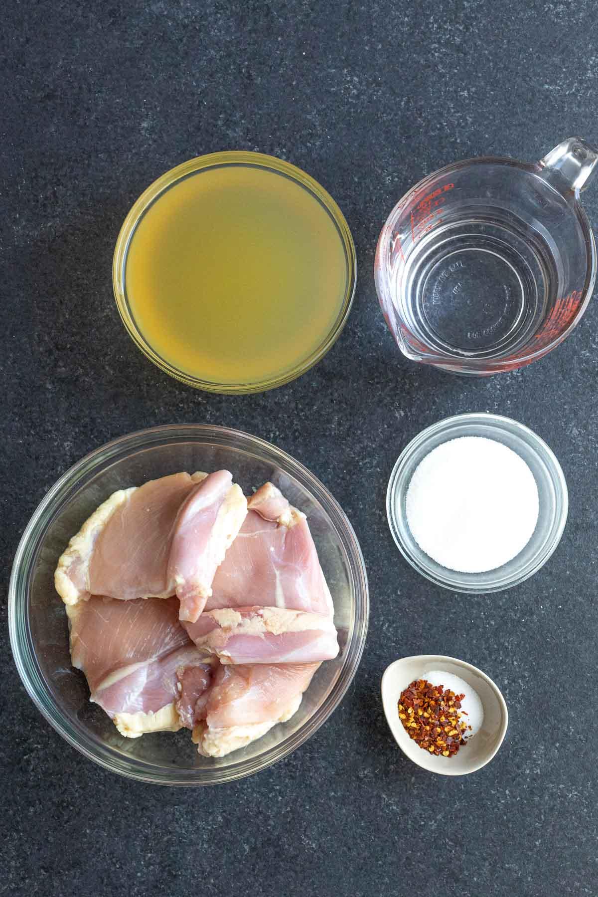 Ingredients for Carolina BBQ Vinegar Shredded Chicken in prep bowls