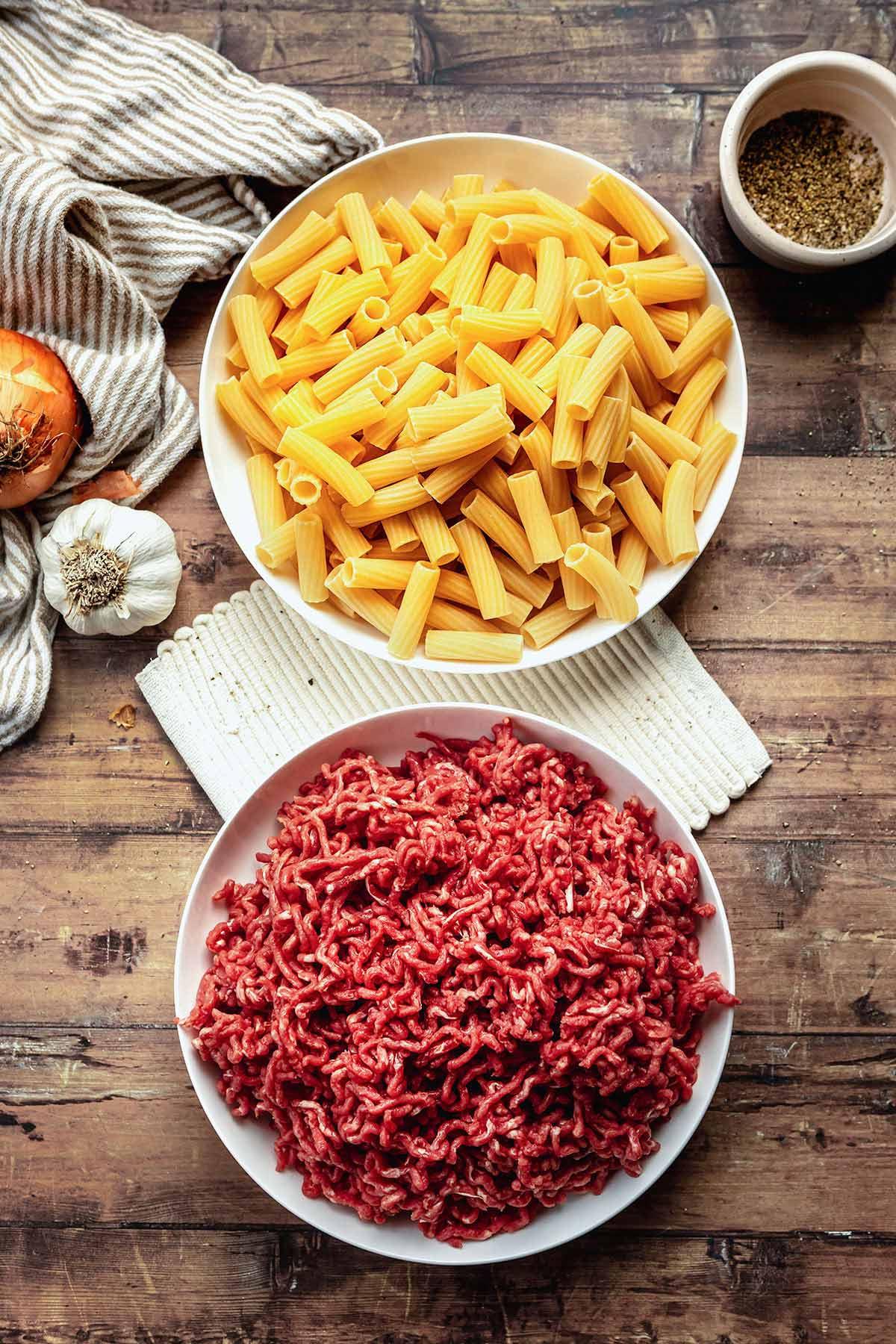 Cheesy Beef Pasta Bake ingredients in prep bowls