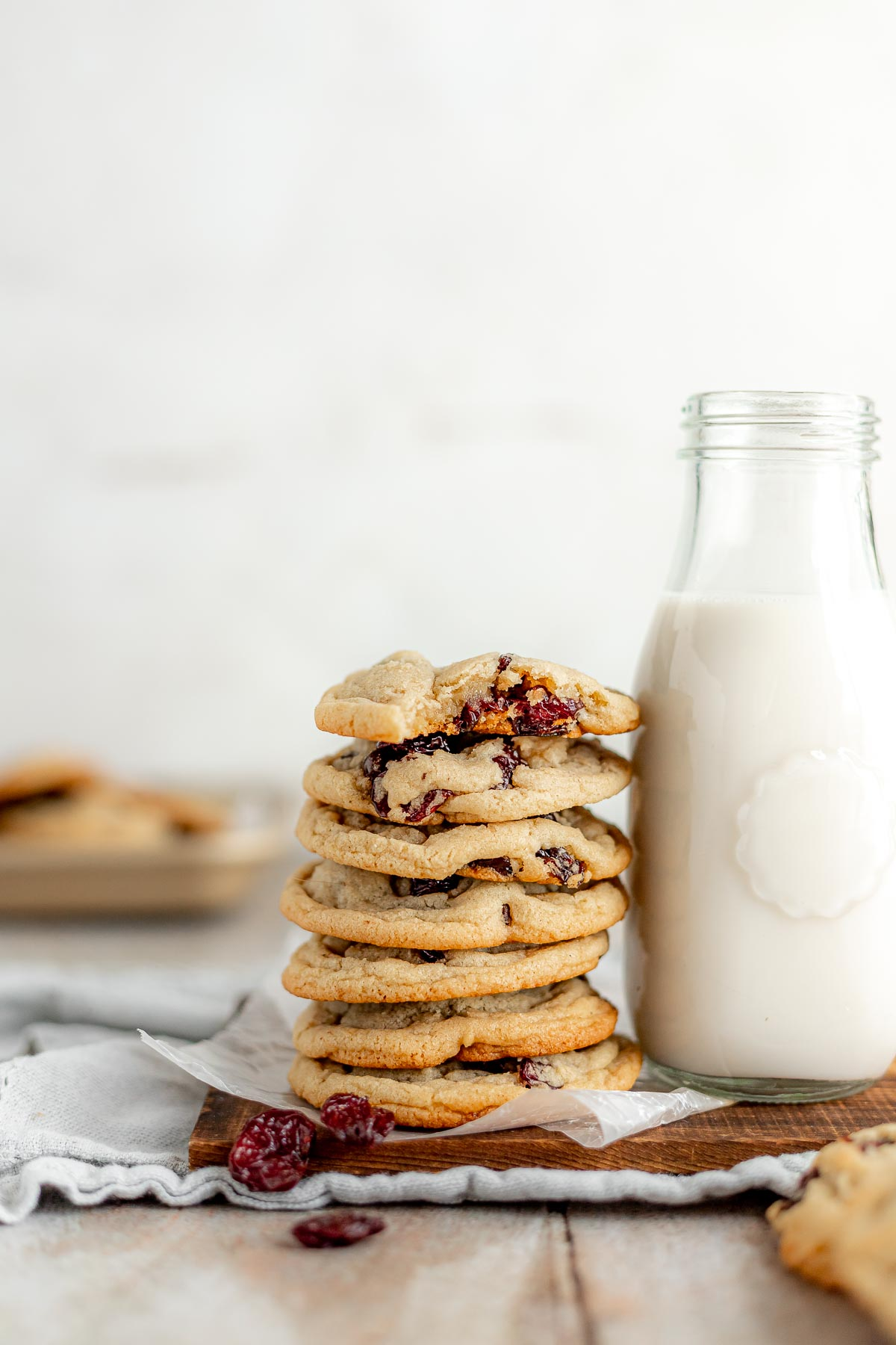 Cherry Chocolate Chunk Cookies in stack with milk jug
