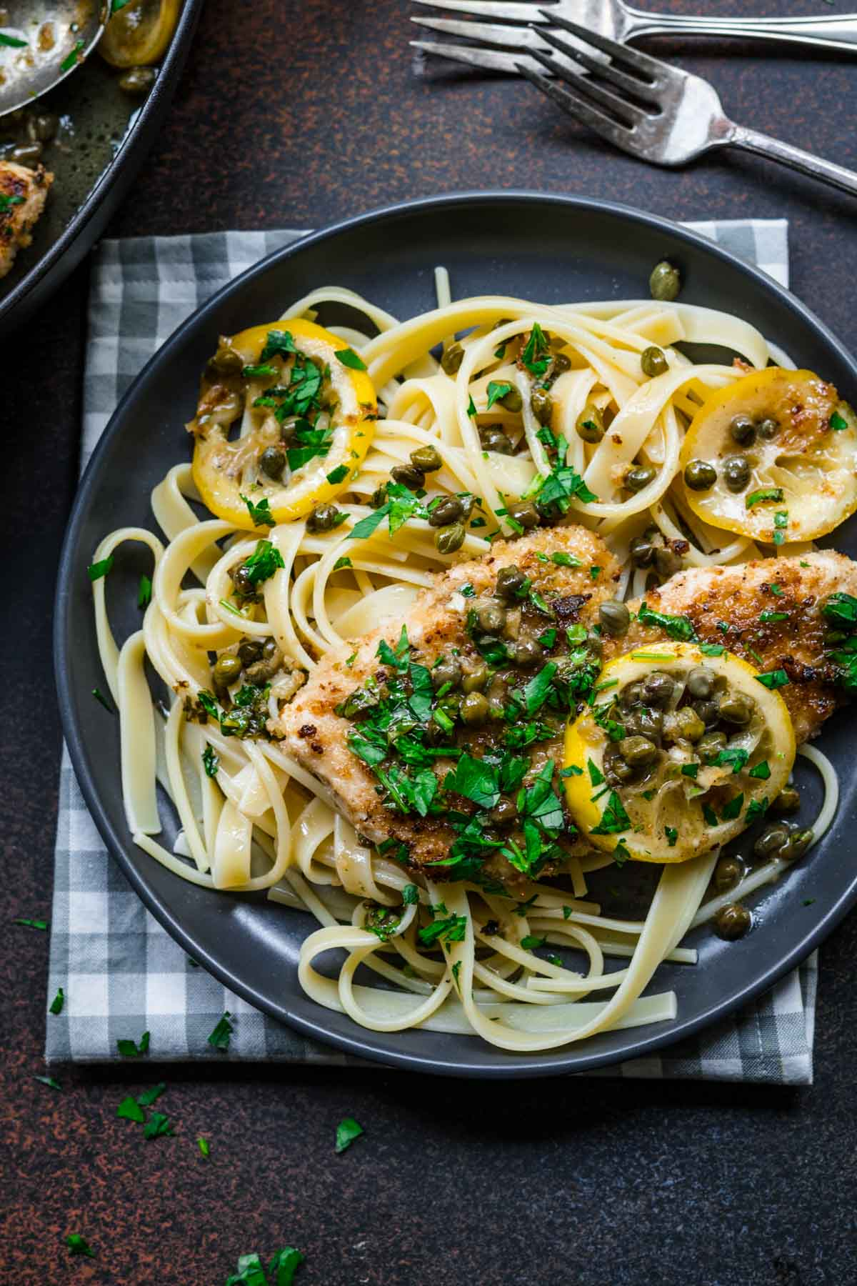 Chicken Piccata on plate with pasta