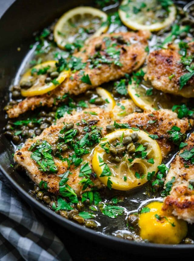 Chicken Piccata in pan with lemon and parsley