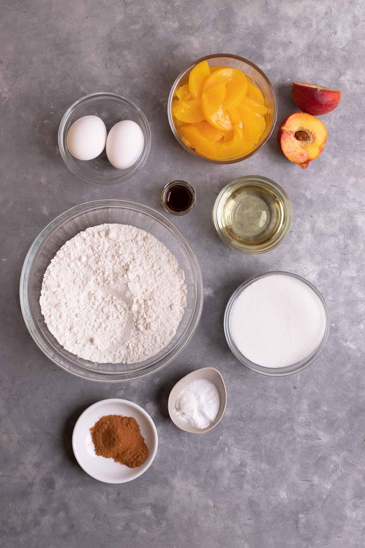 Ingredients for Cinnamon Peach Bread in prep bowls