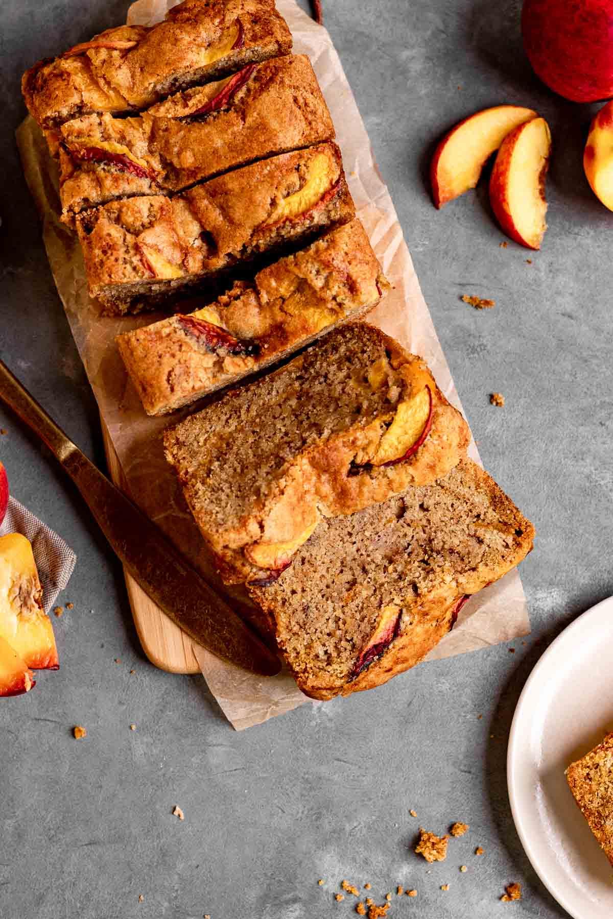 Cinnamon Peach Bread sliced on cutting board