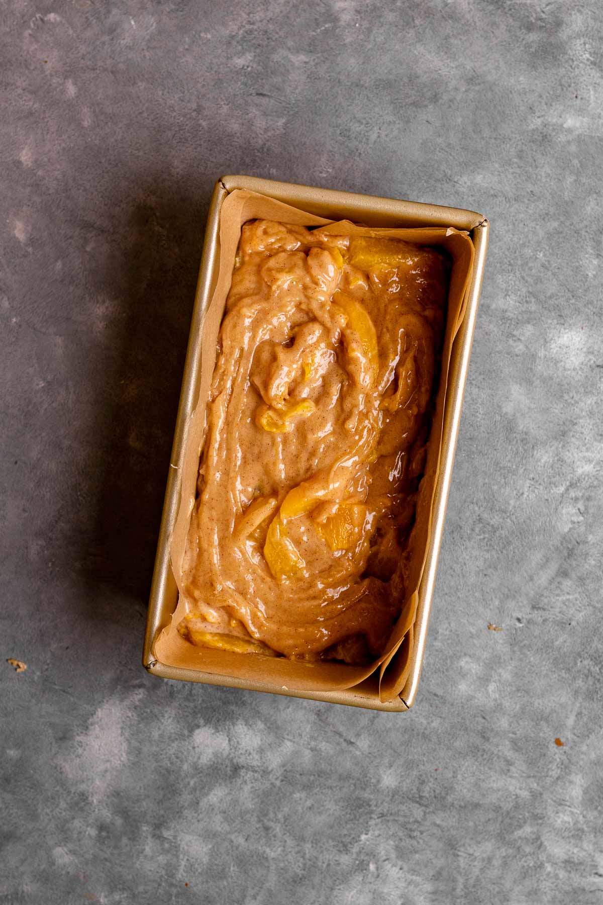 Cinnamon Peach Bread batter in loaf pan