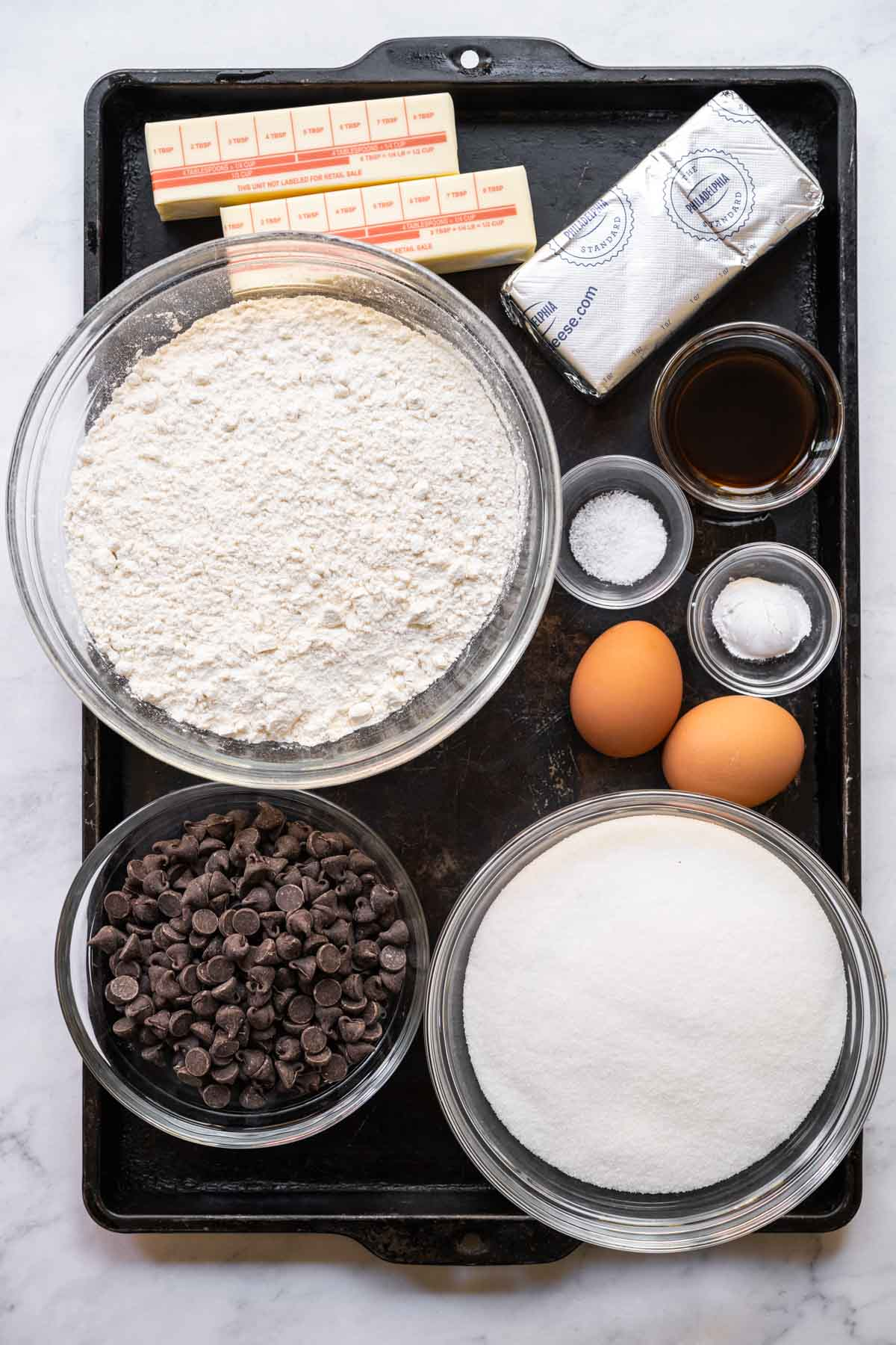 Ingredients for Cream Cheese Chocolate Chip Cookies in prep bowls