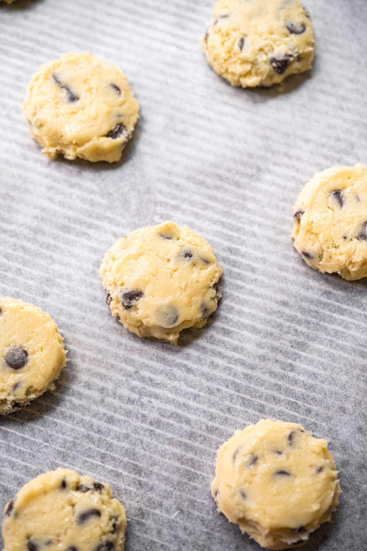 Close up of Cream Cheese Chocolate Chip Cookies dough on baking sheet