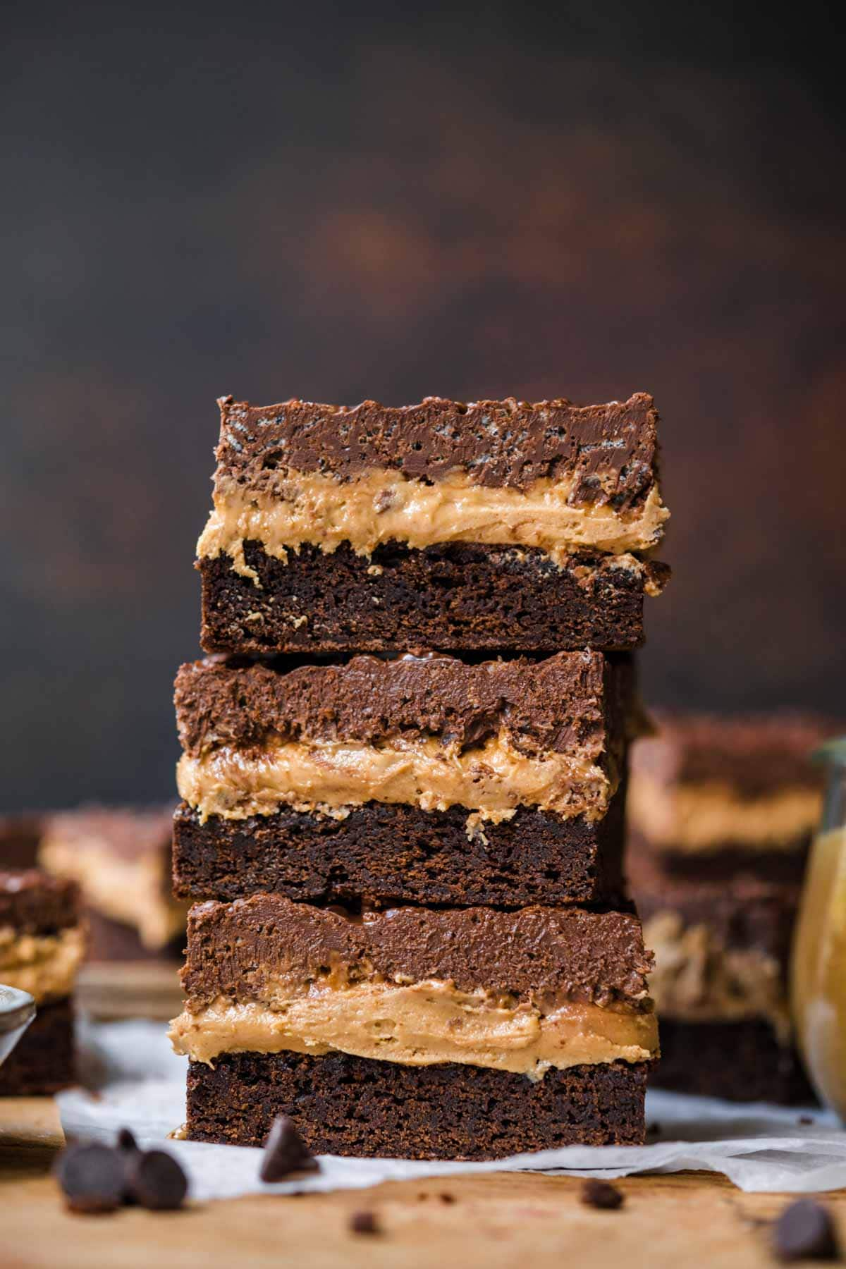 Stacked Crispy Chocolate Peanut Butter Brownie Bars on cutting board