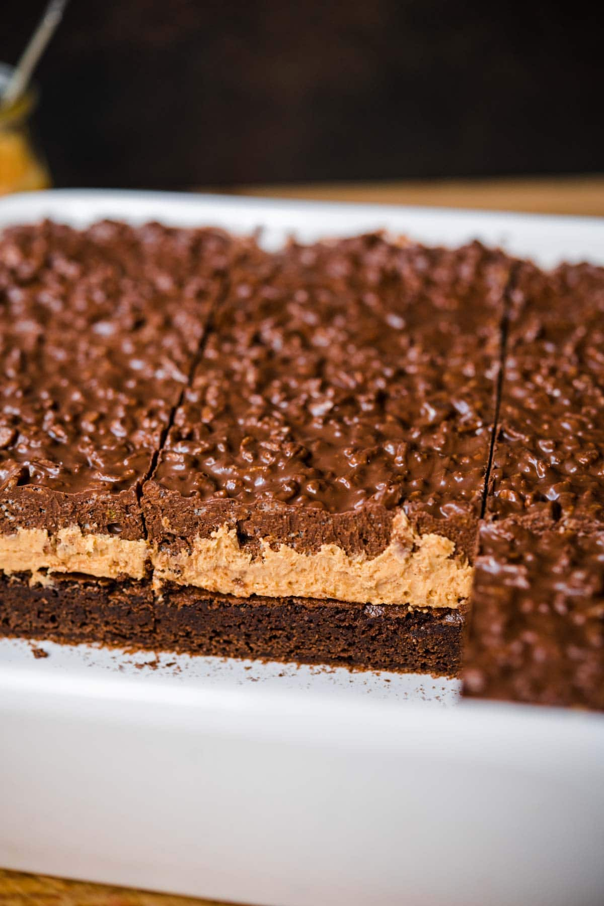 Side view of Crispy Chocolate Peanut Butter Brownie Bars with three layers