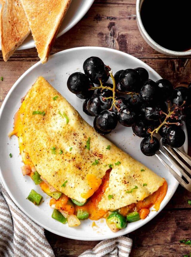 Denver Omelette on plate with black grapes