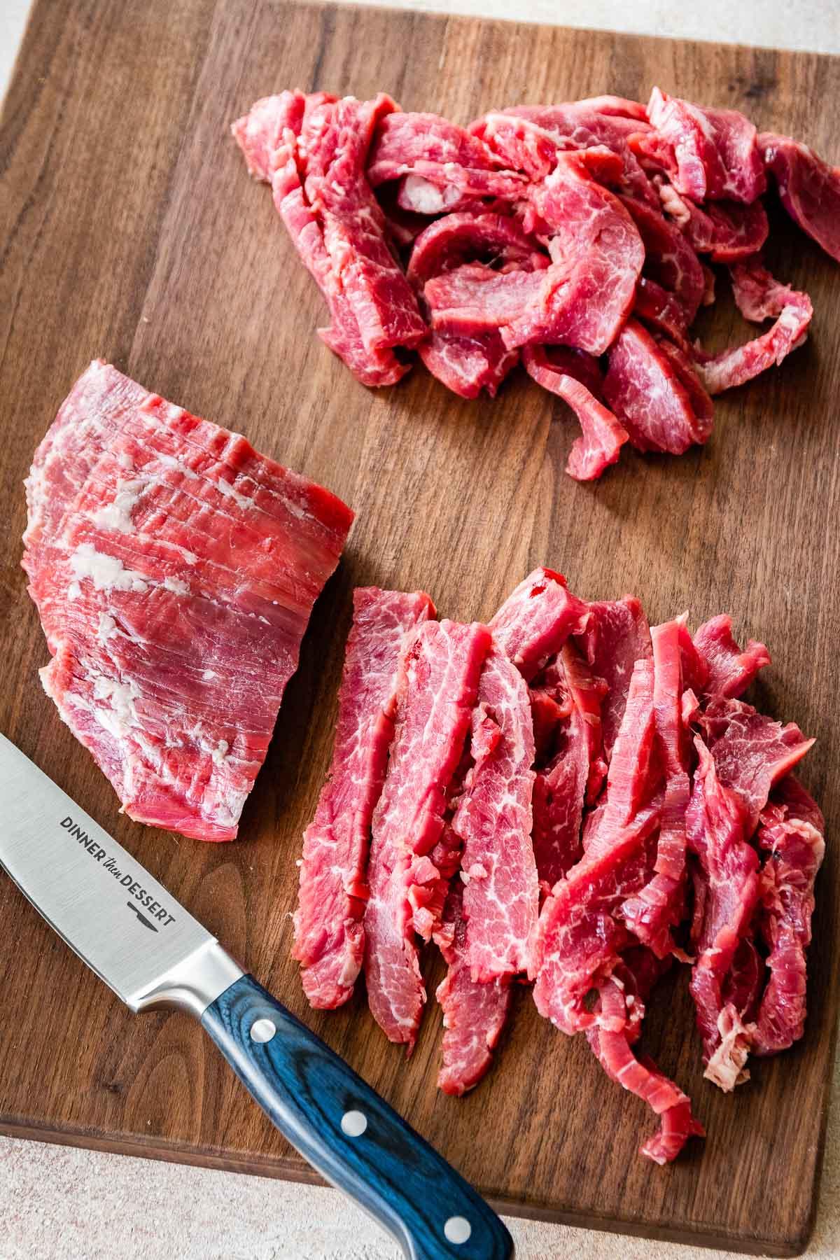 Easy Pepper Steak sliced flank steak on board