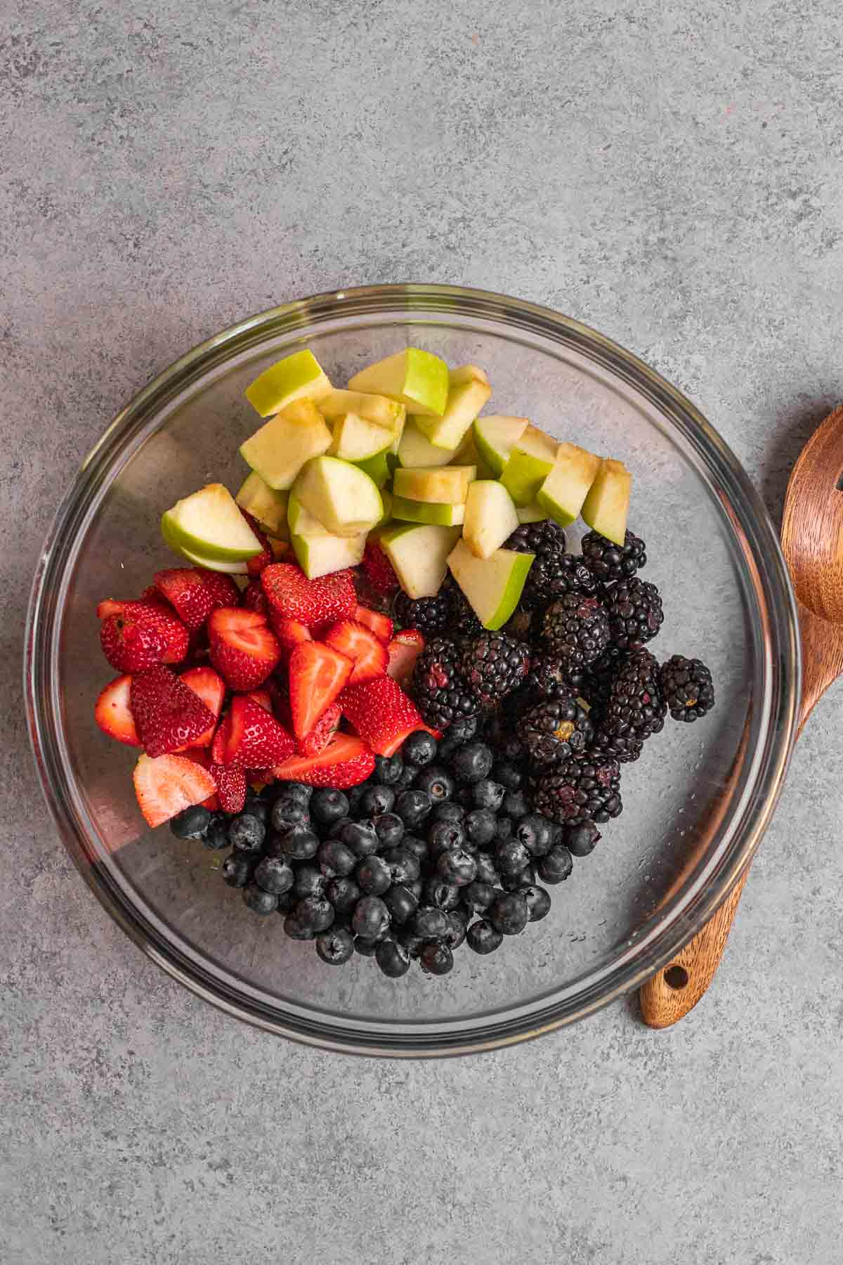 Fruit in mixing bowl for Honey Lime Berry Fruit Salad