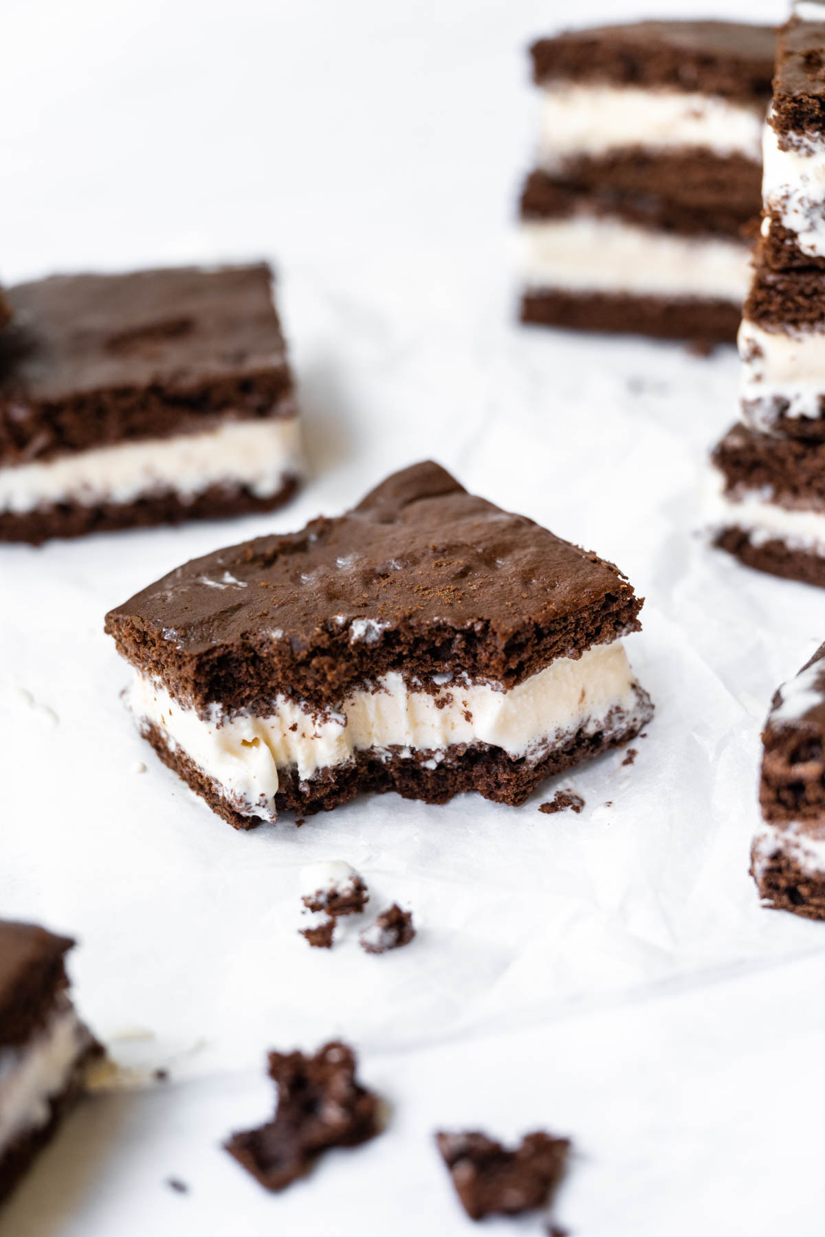 Ice Cream Sandwiches on parchment with bite taken