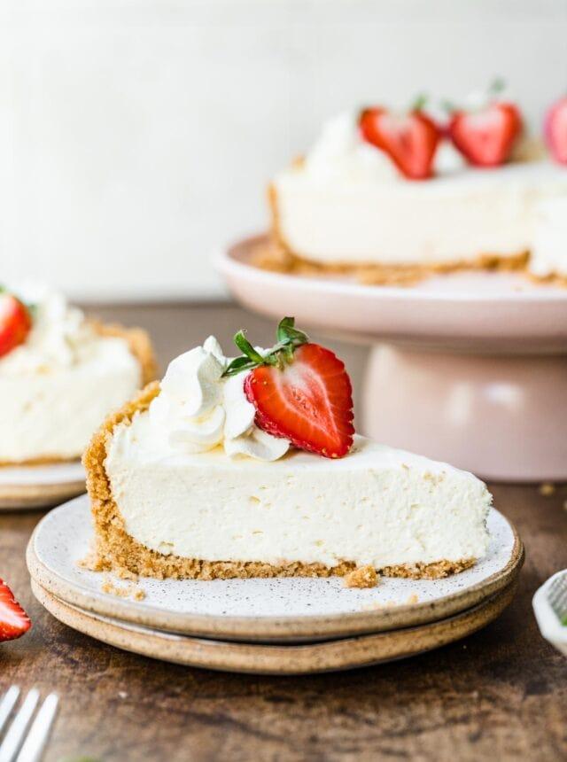 No-Bake Cheesecake sliced with fresh strawberry garnish