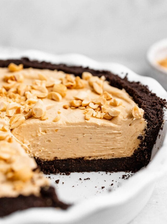 Oreo Peanut Butter Whip Pie in pie dish with slice removed