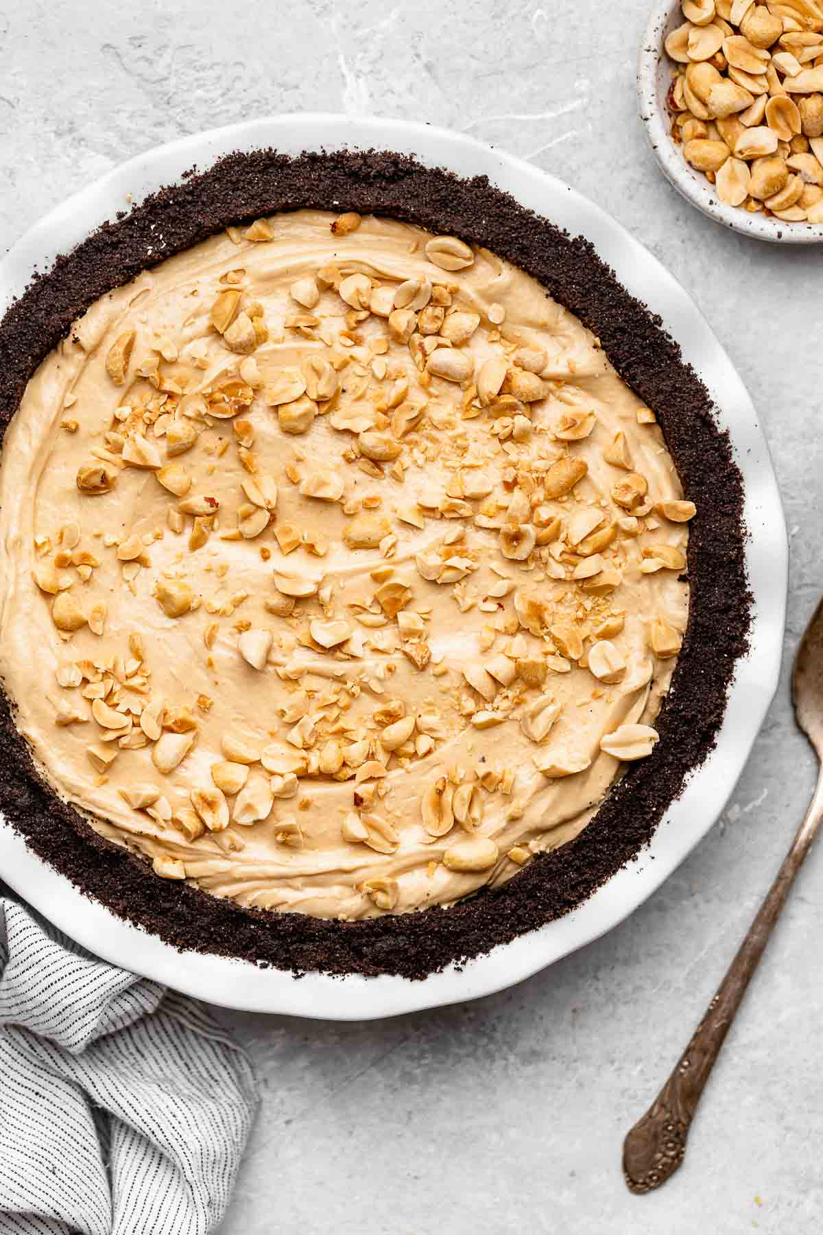 Oreo Peanut Butter Whip Pie in pie dish with chopped peanuts on top