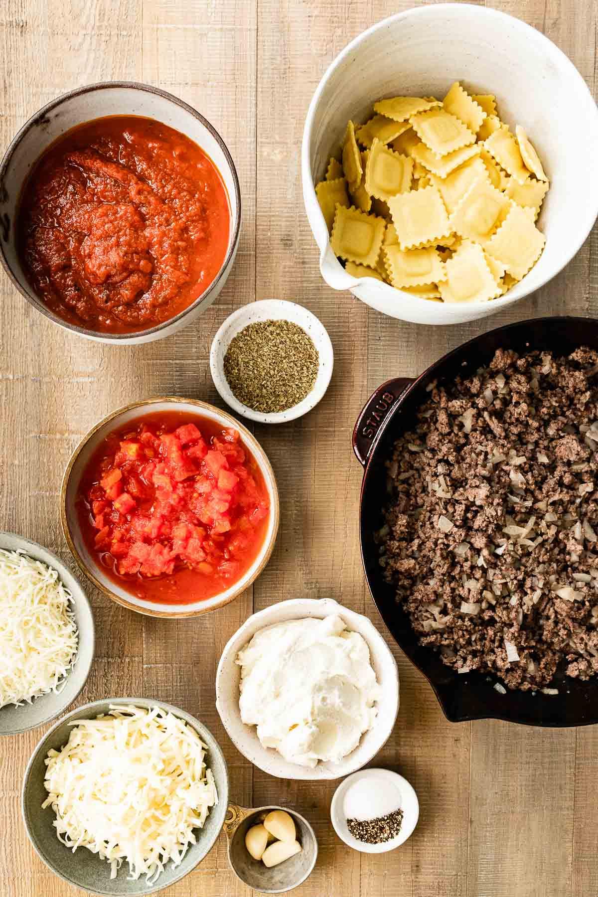 Ingredients in prep bowls for Ravioli Lasagna Bake