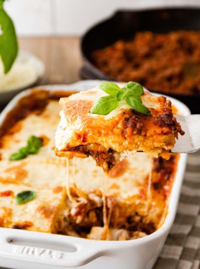 Ravioli Lasagna Bake in baking dish with serving spatula