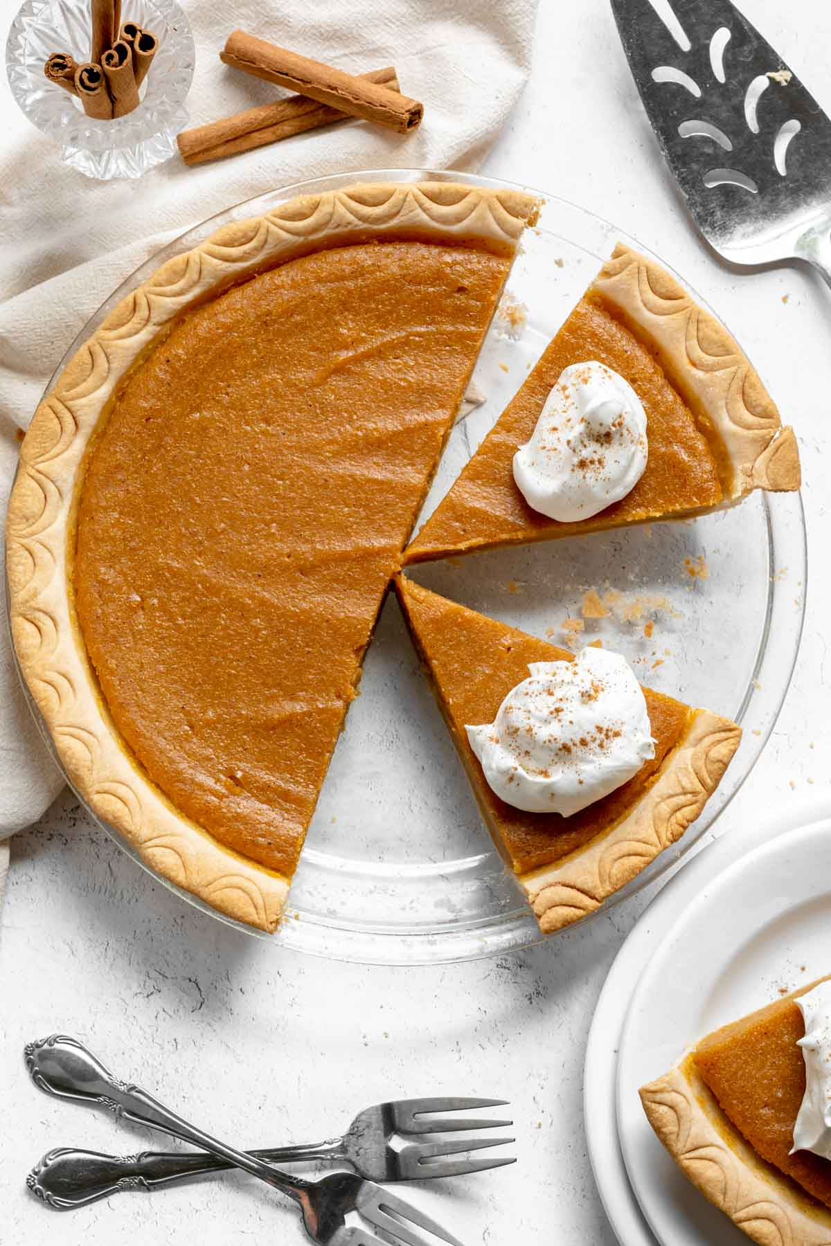 Sweet Potato Pie sliced with whipped cream