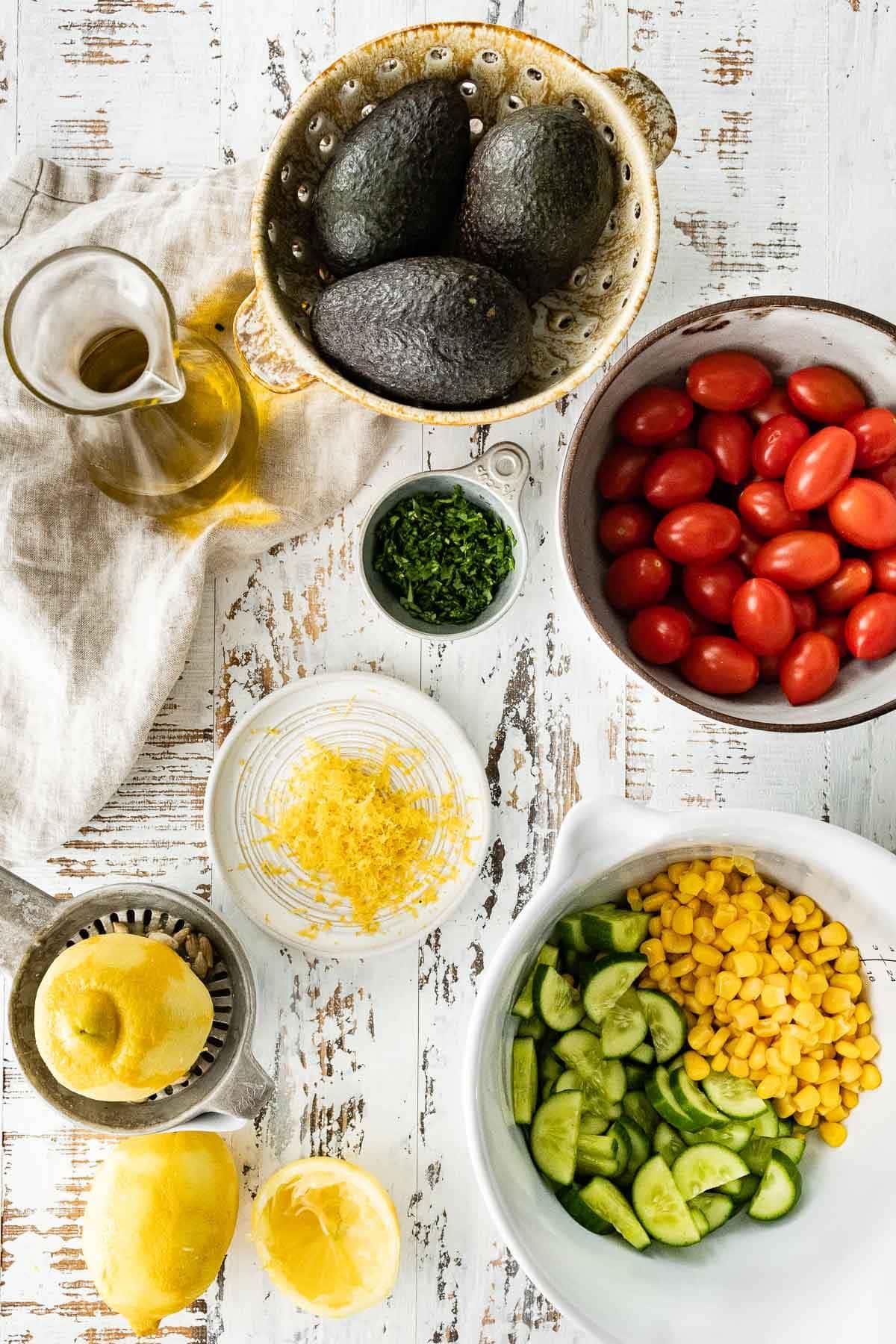 Ingredients for Avocado Tomato Corn Salad in prep bowls