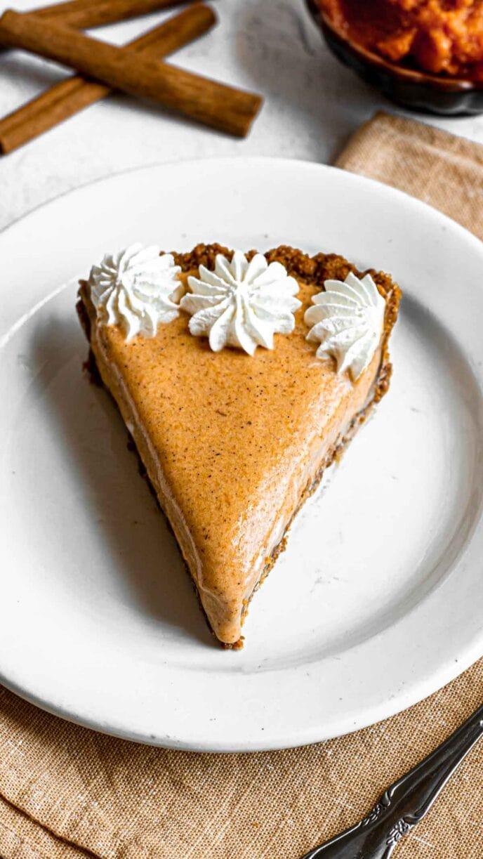 Frozen Pumpkin Ice Cream Pie slice on plate