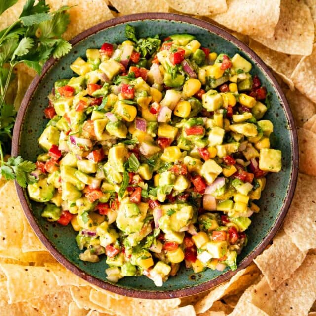 Avocado Salsa in serving bowl with tortilla chips