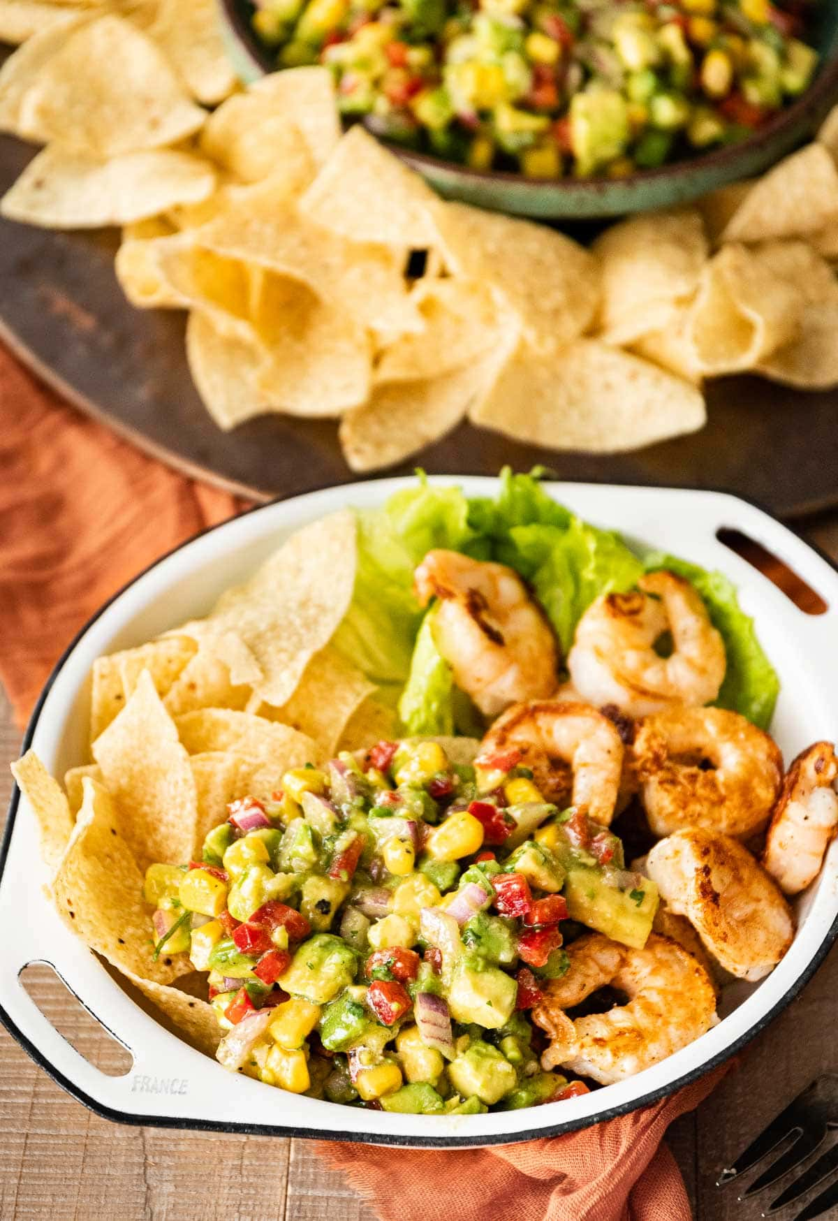 Avocado Salsa served with tortilla chips, lettuce and grilled shrimp