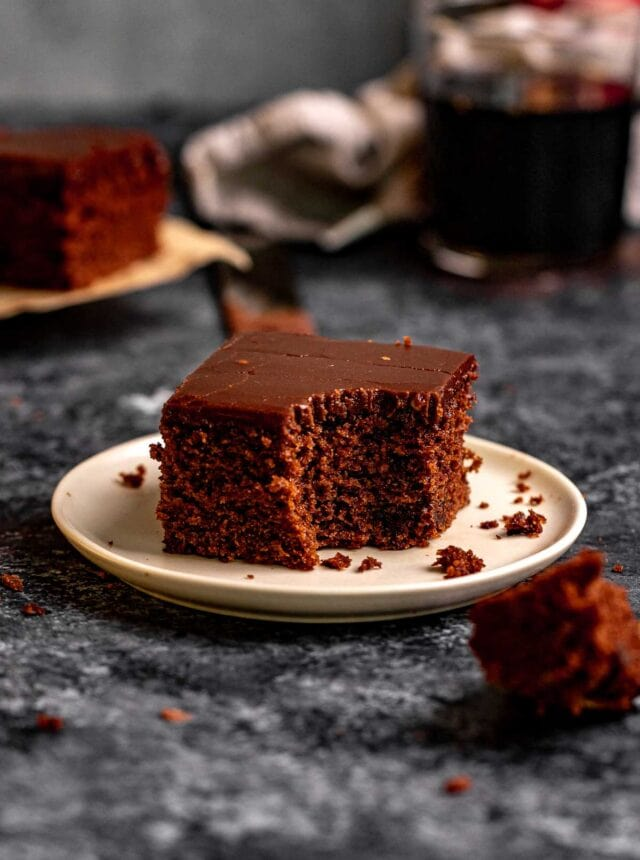 Coca Cola Sheet Cake slice on plate with fork