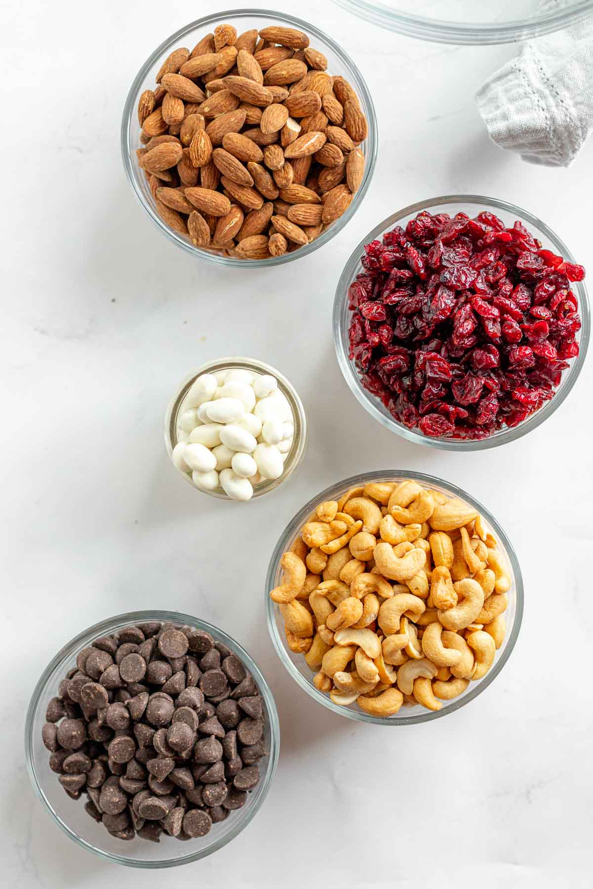 Cranberry Trail Mix ingredients in separate glass bowls
