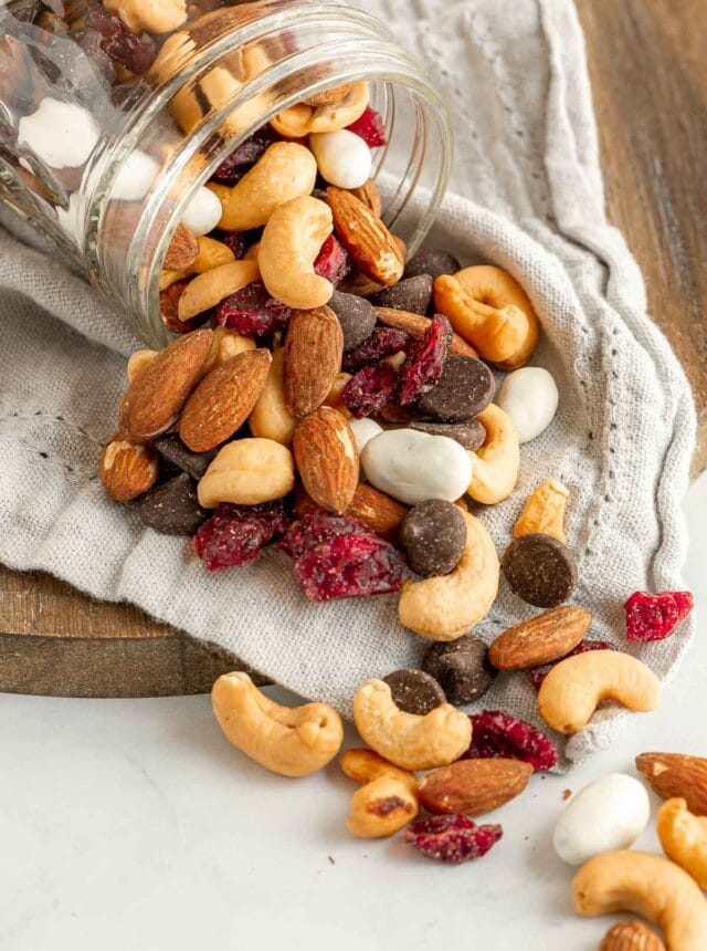 Cranberry Trail Mix spilling out of glass jar