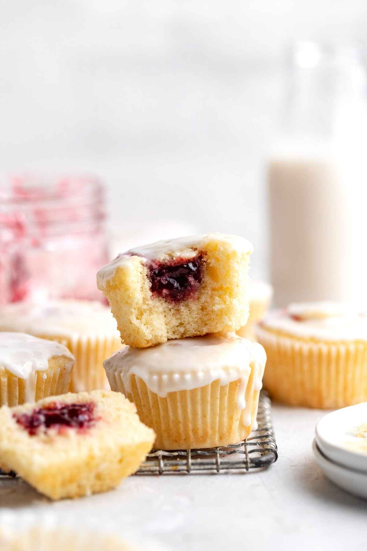 Jelly Doughnut Muffins on wire rack with bite taken