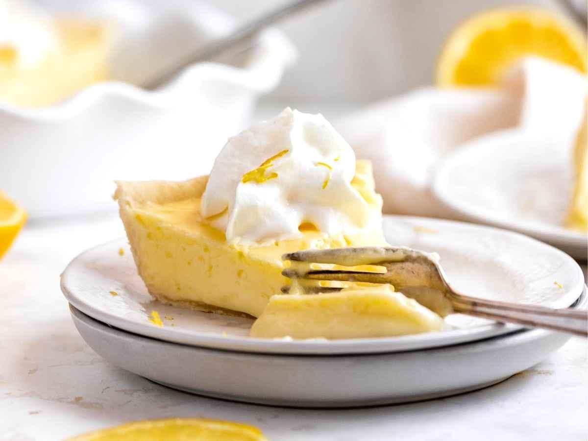 Lemon Chiffon Pie slice on plate with fork