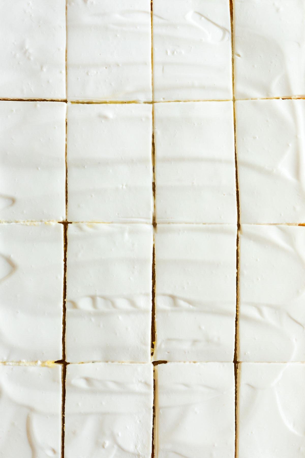 Lemon Shortbread Bars Sliced on board