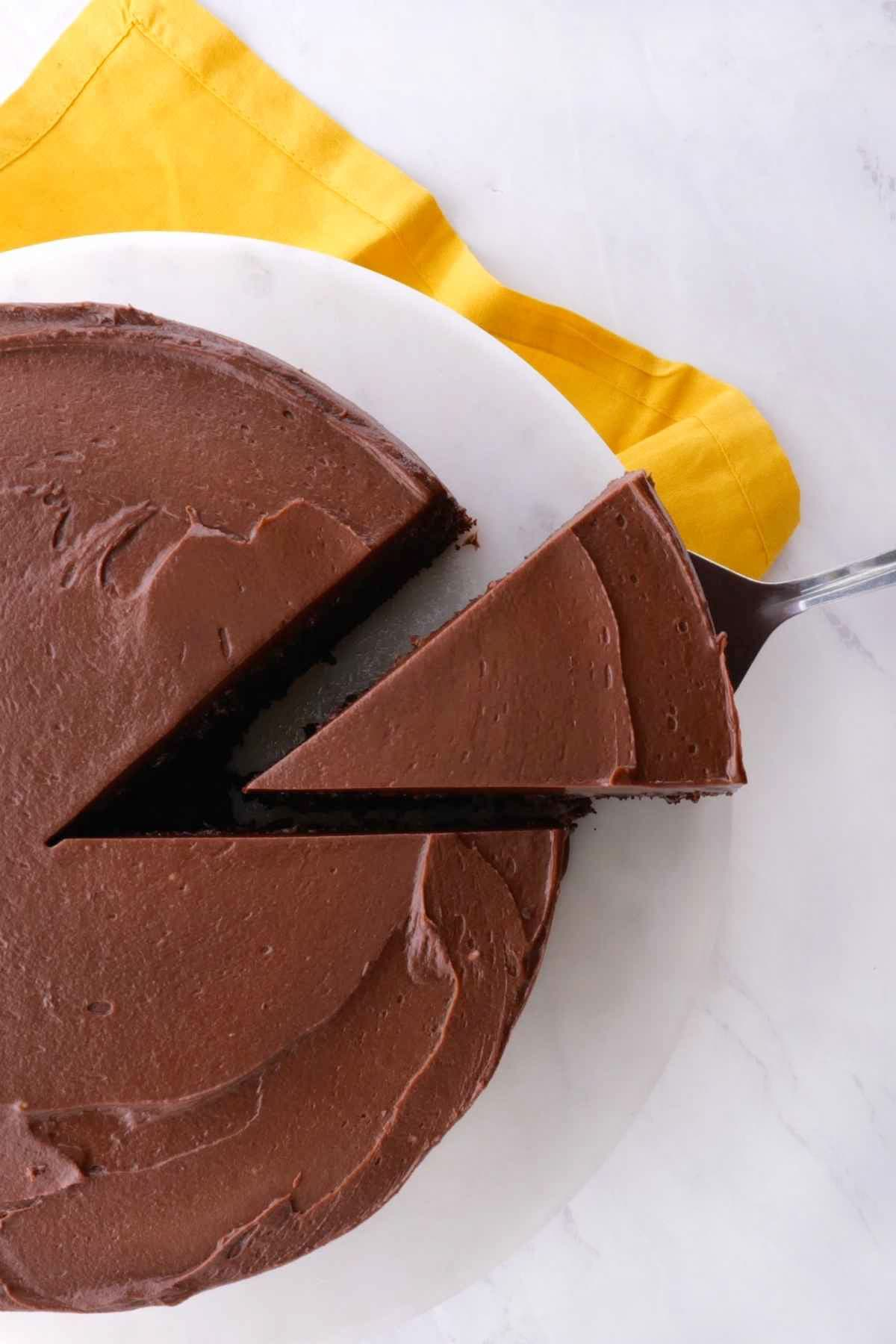 Easy Chocolate Cake frosted with slice