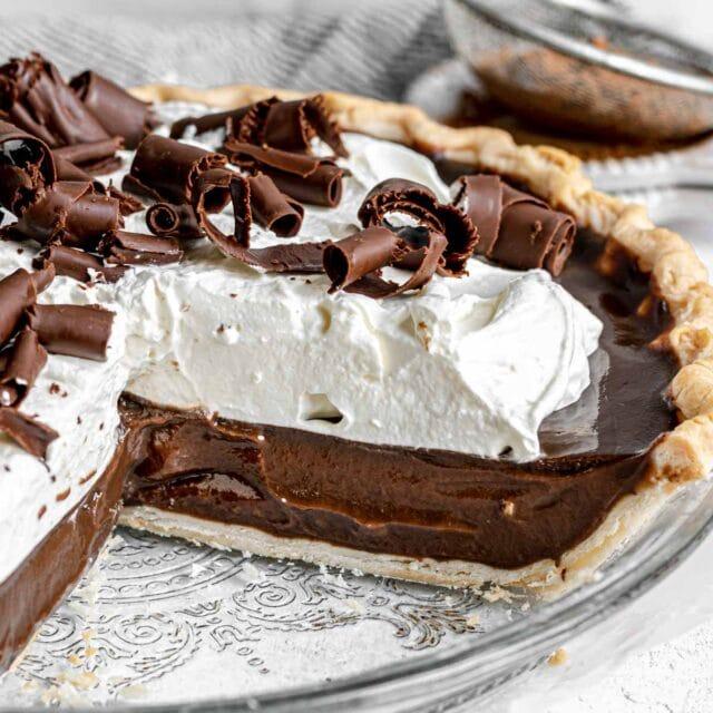 Chocolate Cream Pie with whipped cream and chocolate shavings in pie dish
