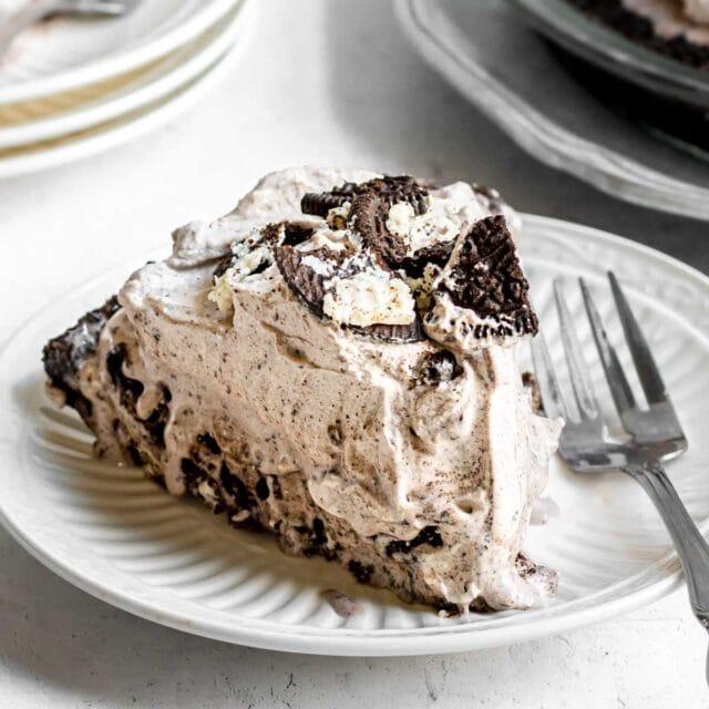 Oreo Ice Cream Pie slice on plate with fork