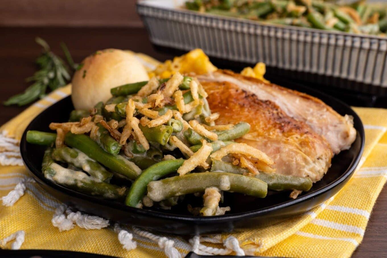 Green Bean Casserole on plate with turkey breast